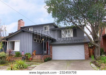 Two Story Ranch Style House, Gray Wood Siding With Red Brick Work. Ranch Style  Is A Domestic Archit