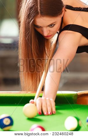 Competition Concept. Young Focused Girl Having Fun With Billiard. Pretty Fashionable Woman Spending