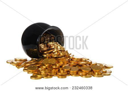 Pot Of Gold Filled With Gold Coins Spilling Over Onto White Surface, Isolated On White Background. F
