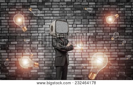 Businessman In Suit With Old Tv Instead Of Head Keeping Arms Crossed While Standing Among Flying Lig