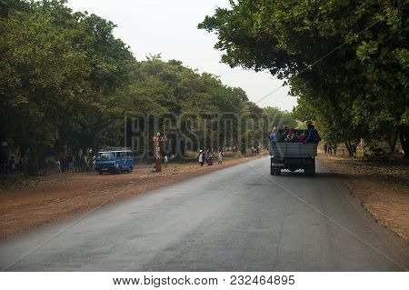 Oio, Republic Of Guinea-bissau - January 28, 2018: Group Of People Traveling In The Back Of A Truck