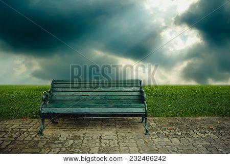 Old Green Wooden Bench And Nature Background.