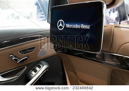 Geneva, Switzerland - March 7, 2018: Rear Seat Car Entertainment System In A Mercedes Benz Lluxury C