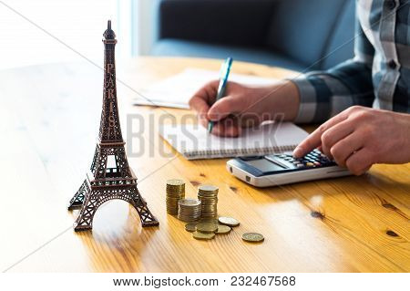 Man Counting Travel Budget, Vacation Expenses Or Insurance Cost. Traveler Planning Holiday In Europe