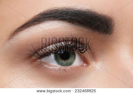 Young woman with permanent eyebrows makeup, closeup