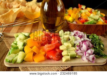 Chopped Vegetables On A Wooden Board. Salad Ingredients