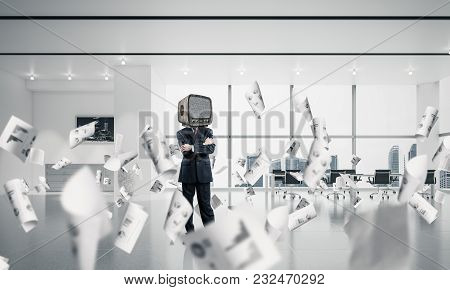 Businessman In Suit With An Old Tv Instead Of Head Keeping Arms Crossed While Standing Among Flying