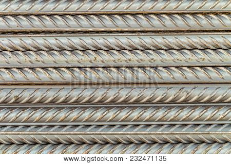 Steel Reinforcing Bars Rods With Periodic Profile. Industrial Abstract Background.