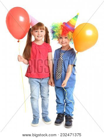 Cute little kids in party caps on white background. April fool's day celebration
