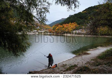 The Fisherwoman By The Lake Near The Crimean Mangup-kale Mountain