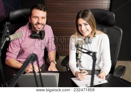 Two Radio Hosts Moderating A Live Show For Radio