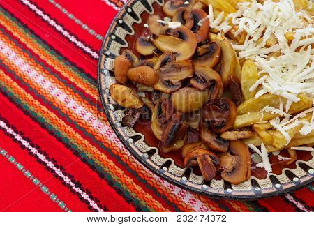 Bulgarian Traditional Home Food On The Traditional Plate. Fried Mushrooms And Potato With Goat White