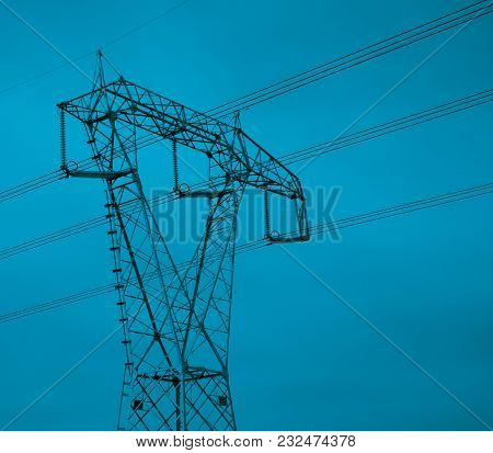 High Voltage Electricity Tower With Wires, Landscape. Photo Depicting One High Voltage Powerful Towe