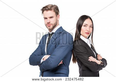 Side View Of Multicultural Business Colleagues With Arms Crossed Standing Back To Back Isolated On W