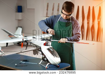 Young Male Engineer Or Technician Repair Drone