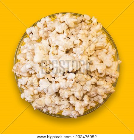 Popcorn In A Transparent Plate On A Yellow Background