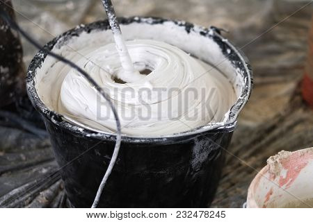 Mixing Of A Plaster Solution By An Electric Drill