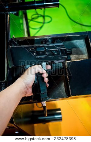 Hand Holding Machine Gun For Shootting Game At The Shopping Mall.