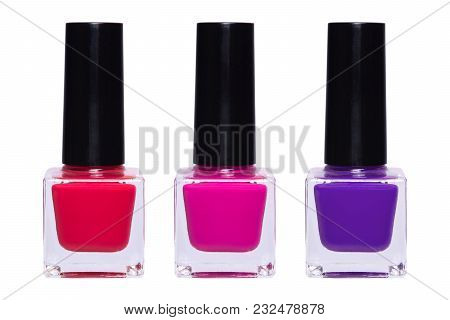 Red, Purple And Violet Bottle Of Nail Polish Isolated On White Background.