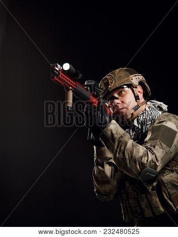 Picture of aiming soldier with gun