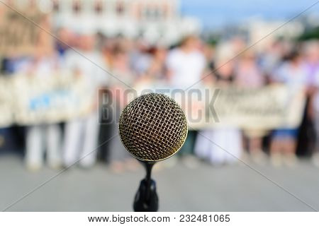 Microphone On Stage With Blurred Colorful Bright Light For Communication Concept Background