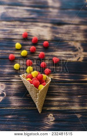Horn With Sweets On A Wooden Background.