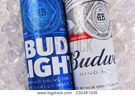 Irvine, California - March 21, 2018: Budweiser And Bud Light King Cans On Ice Closeup. Budweiser And