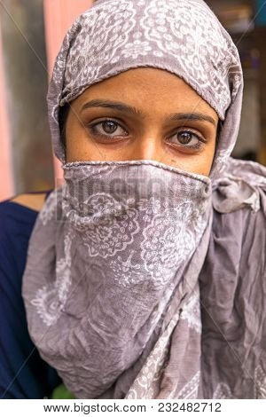 Mandawa, India - February 24, 2018: Portrait Of A Young Indian Girl With Headscarf.
