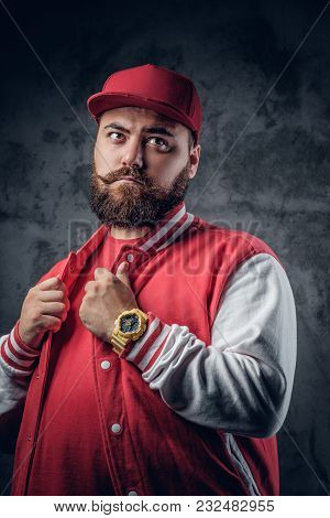 Portrait Of Fatty Bearded Male In Hip Hop Clothes And Baseball Cap On Grey Background.