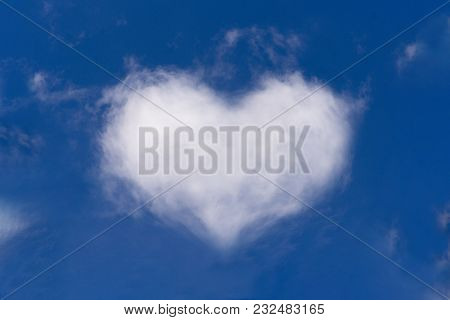 White Clouds In The Shape Of Heart On A Blue Sky