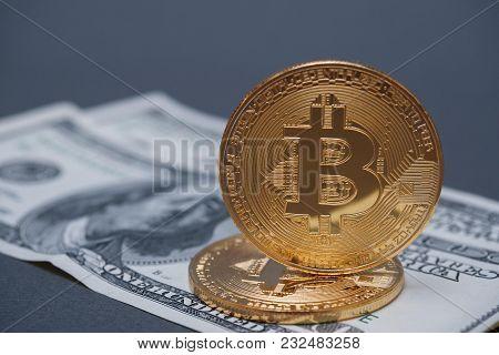Golden Bitcoins On The Background Of Dollar Bills