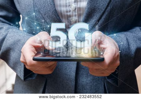 Businesswoman Showing Symbol 5g On Mobile Device.