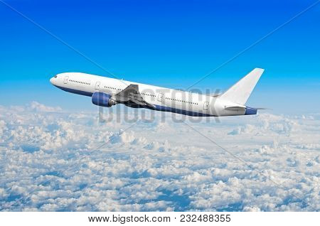 Passenger Airplane Fly On A Hight Above Overcast Clouds And Blue Sky