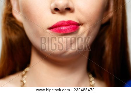 Portrait Of Insecure Woman Having Doubts. Displeased Redhead Girl Thinking, Making A Face. Close Up