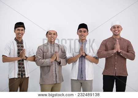 Group Of Muslim Man Who Greeting And Smiling In Front Of The Camera. Muslim Eid Mubarak Concept