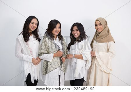 Group Of Muslim Asian Women Smiling And Greeting. Embracing Each Other During Eid Mubarak Celebratio