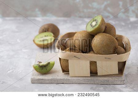 Kiwi Fruit Half Of Qiwi Isolated On White Concrete Background. Cut Of Green Sweet Kiwi. Kiwi Healthy