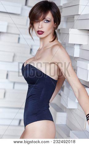 Awesome Female In A Black Underwear Posing In Studio.