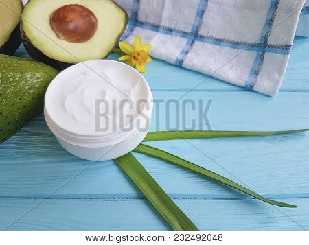 Avocado Cream On A Blue Wooden Yellow Flower
