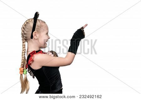 Child Girl In A Cat Costume Points In The Sideways With The Index Finger Of A Bent Hand Isolated On