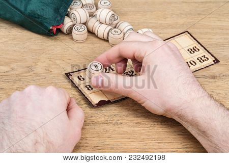 Male Hand Closes The Figure With Eight Wooden Barrels In A Lotto Game