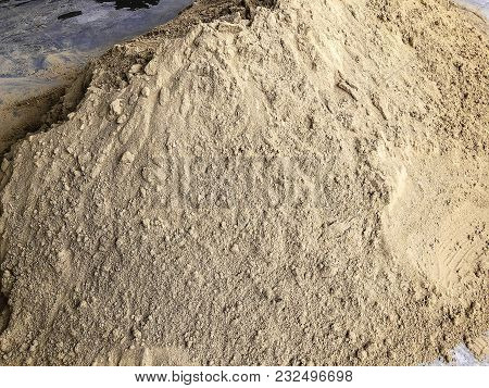 A Pile Of Sand At A Construction Site. Construction Materials