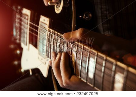 Musician Man Is Playing The Guitar On The Concert