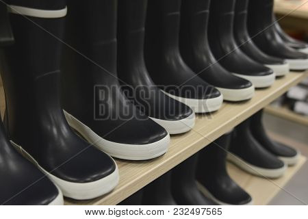 Black Rubber Boots On A Store Shelves In A Shop