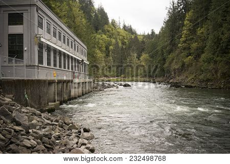 Water Flows Around The Corner After Falling Down Snoqualmie Falls And Thru The Power House