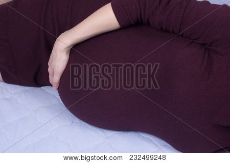 Baby Waiting Women Laying In Bed At Home