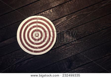 Success, Achievement, Target, Goals Concept Dart Board On Wood