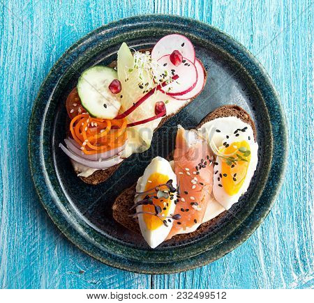 Healthy Breakfast Toasts. Wholegrain Rye Bread Slices With Cream Cheese, Eggs, Salmon, Carrot, Cucum