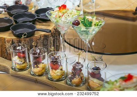 Beautiful Catering Banquet Table With Different Food Snacks And Appetizers Decorated For Celebration
