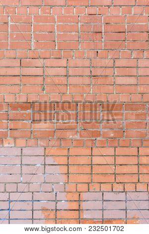 The Wall Of Bricks Is Unglued Dirty Orange. Beautiful Background Of Smooth Masonry. Texture.